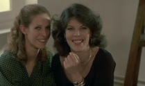 Christine and Liliane laughing at Antoine